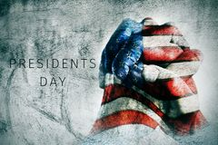 Hands with flag of US and text presidents day royalty free stock photo