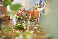 hands of florist collect wedding bouquet at work royalty free stock images