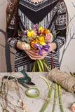 Hands of florist making bouquet spring flowers Stock Photos