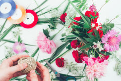 The hands of a florist male making beautiful flower composition Royalty Free Stock Photography