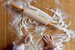 Hands and flour Stock Photography