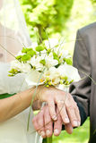 Hands and flower bouquet Stock Photography