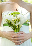 Hands and flower bouquet Royalty Free Stock Photos