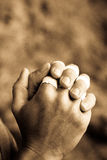 Hands folded. Climber's hands folded in a prayer Royalty Free Stock Photo