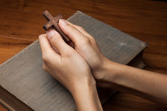 Hands folded in prayer over Holy Bible Royalty Free Stock Photography