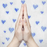 Hands folded in prayer, then with blue hearts. Hands folded in prayer then with blue hearts Stock Images