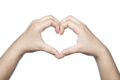 Hands folded in the shape of a heart indicate the love Stock Images