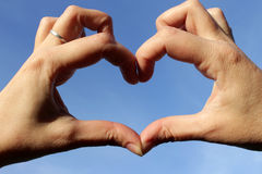 Hands folded in the shape of a heart Royalty Free Stock Image