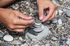 Hands folded small stones Royalty Free Stock Photos