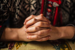 Hands folded royalty free stock photography
