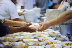 Hands-on food of the hungry is the hope of poverty : concept of homelessness. The hands of the poor receive food from the hands of the philanthropist : concept stock photos