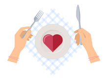 Hands with fork and knife, plate with red jelly heart. Royalty Free Stock Photography