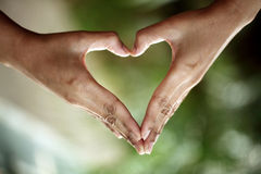 Hands in the form of heart shape Stock Images