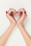 Hands in the form of heart symbol Stock Image