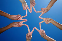 Hands form a star with fingers royalty free stock photography