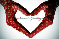 Hands Forming A Heart And The Sentence Seasons Greetings Royalty Free Stock Photo