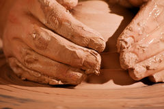 Hands forming clay Stock Photo