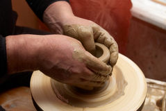 Hands forming clay pot Stock Image