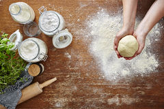 Hands forming dough atmospheric kitchen scene. 