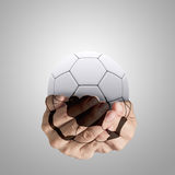 Hands forming a football. And 3d ball Stock Photos