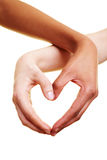 Hands forming a heart Stock Photos