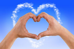 Hands forming heart cloud. Two Hands forming heart cloud Royalty Free Stock Photo
