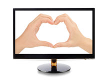 Hands forming a heart  in monitor. Isolated on white Royalty Free Stock Photography