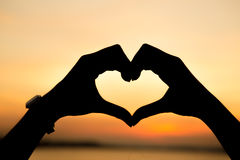 Hands forming a heart shape Stock Photos