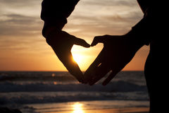 Hands forming a heart at the sunset Royalty Free Stock Photo