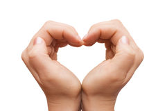 Hands forming a heart on white background Royalty Free Stock Photos
