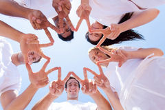 Hands forming star. Group of people hands forming a star shape outdoors Royalty Free Stock Photos