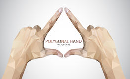 Hands forming triangle sign Royalty Free Stock Images