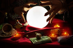 Hands from fortune teller above crystal ball Stock Photo
