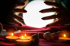 Hands of fortune teller around crystal ball. Hands of fortune teller around shiny crystal ball stock photos