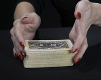 Hands of the fortuneteller. On a black background Royalty Free Stock Photo