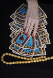 Hands of the fortuneteller. On a black background Royalty Free Stock Images