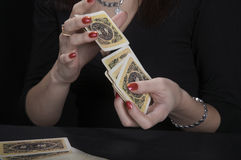 Hands of the fortuneteller. On a black background Stock Images