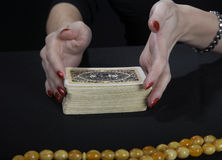 Hands of the fortuneteller. On a black background Stock Photo