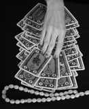 Hands of the fortuneteller. On a black background Royalty Free Stock Photos
