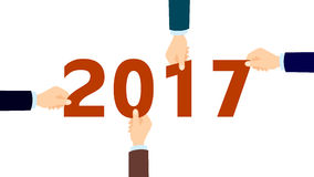 Hands with 2017. Four hands holding next year numbers. Concept of new year, future business and team building Royalty Free Stock Image
