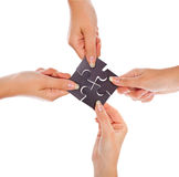 Hands with four puzzles Royalty Free Stock Image