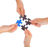 Hands with four puzzles Royalty Free Stock Images