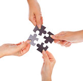 Hands with four puzzles Stock Photo