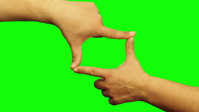 Hands frame sign gesture isolated. Green screen stock footage