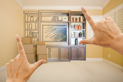 Hands Framing Drawing of Entertainment Unit Gradating Into Photo. Graph In Room With Moving Boxes royalty free stock photography