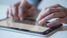 Hands of freelancer typing message on tablet pc, sending project to client. Stock footage stock video footage
