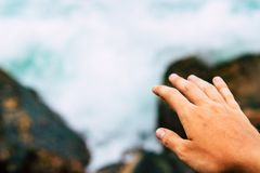 Hands in for friendship and saving water and ocean concept close up stock image