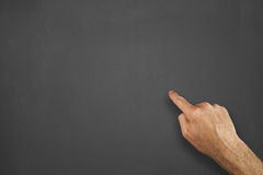 Hands in front of chalkboard. Mans hands on a chalkboard Royalty Free Stock Images