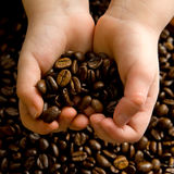 Hands full of coffee Royalty Free Stock Photography