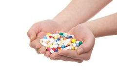 Hands full of pharmaceuticals Royalty Free Stock Photos